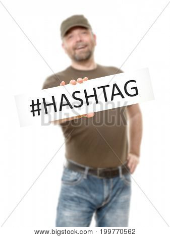 A bearded man with a white board and the message hashtag
