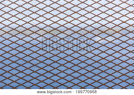 Metal grid as decorative or protective fence