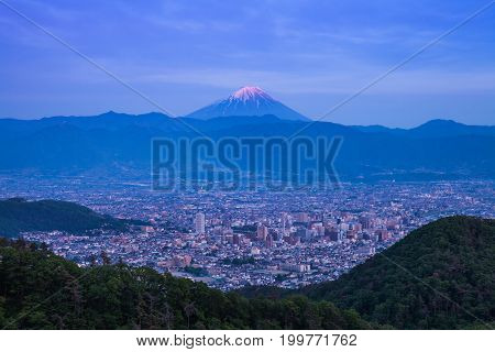 Mount Fuji and Kofu city at night time