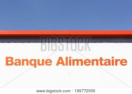 Sassenage, France - June 25 2017: Food bank sign on a wall called banque alimentaire in french