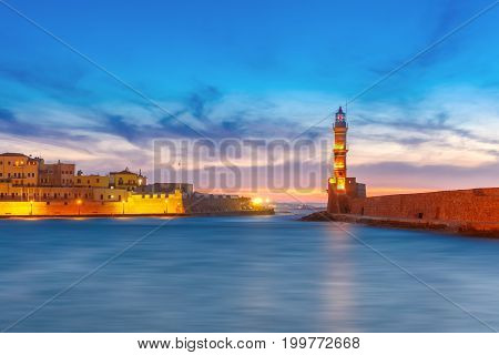 Panorama venetian harbour waterfront and Lighthouse in old harbour of Chania at sunset, Crete, Greece