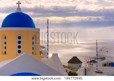Picturesque view, Old Town of Oia or Ia on the island Santorini, white houses and church with blue domes, Greece