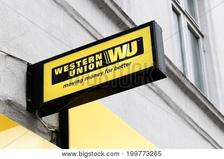 Aarhus, Denmark - July 15, 2017: Western Union sign and logo on a facade. The Western Union company is an american financial services and communications company
