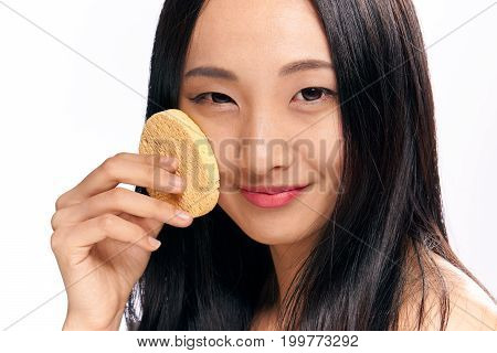 Woman on white isolated background, makeup remover, portrait, asian.