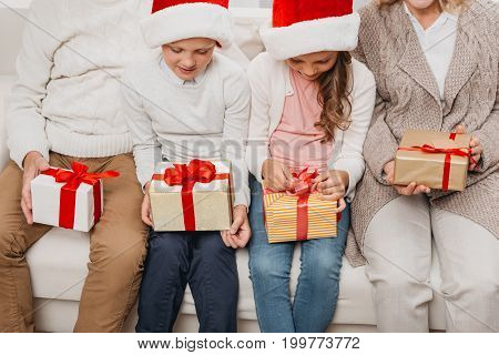 Kids With Christmas Gifts And Grandparents
