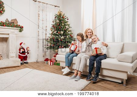 Woman And Kids With Christmas Gifts