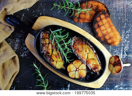 eggplant with garlic and rosemary in a cast iron skillet
