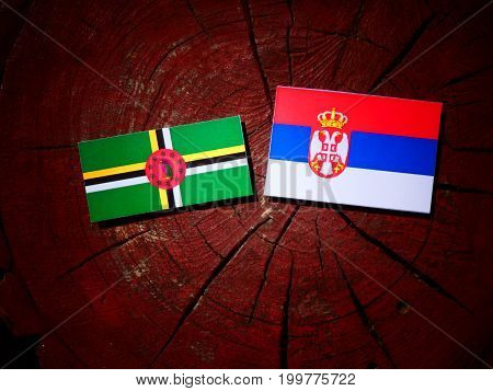 Dominica Flag With Serbian Flag On A Tree Stump Isolated