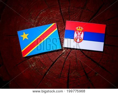 Democratic Republic Of The Congo Flag With Serbian Flag On A Tree Stump Isolated