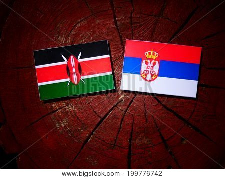Kenyan Flag With Serbian Flag On A Tree Stump Isolated