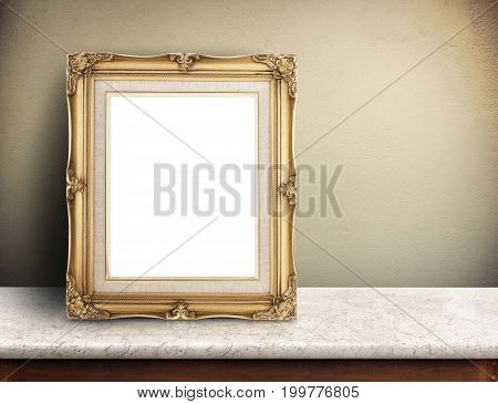 Blank Gold Victorian Picture Frame On Marble Table At Yellow Concrete Wall,template Mock Up For Addi