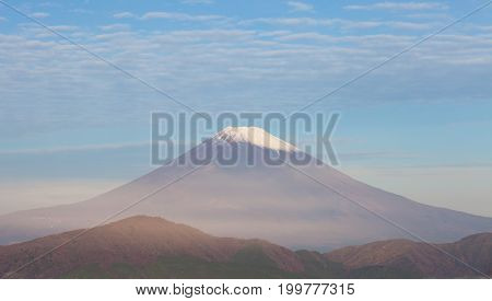 Top of Mt. Fuji and cloud in autumn morning