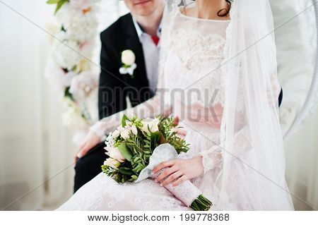 Close-up Photo Of A Bouquet In Bride's Hands.