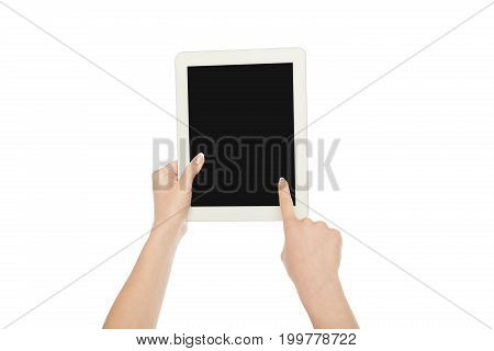 Female hand holding digital tablet and pointing with index finger on blank screen isolated on white background, close-up, cutout, copy space on the screen