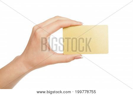 Female hand holding blank plastic credit card isolated on white background, close-up, cutout, side view