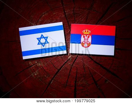 Israeli Flag With Serbian Flag On A Tree Stump Isolated