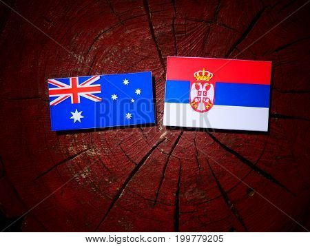 Australian Flag With Serbian Flag On A Tree Stump Isolated