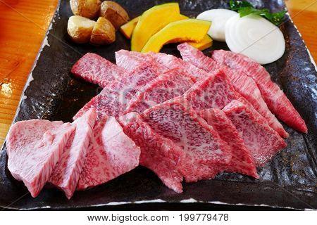 Wagyu kalbi meat and vegetable on dish at BBQ yakiniku grill buffet restaurant