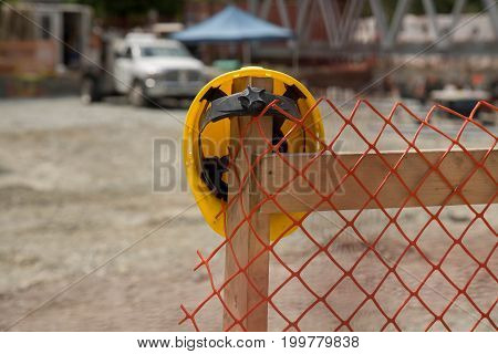 No people yellow worker helmet fence abstract