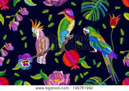 Seamless vector pattern with embroidered texture. Parrots, palm leaves, flowers. Beach textile collection.