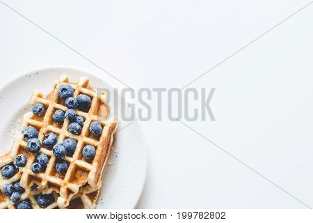Pile Of Tasty Fresh Waffles With Blueberries On Plate