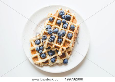 Top View Of Plate Of Tasty Fresh Waffles With Blueberries