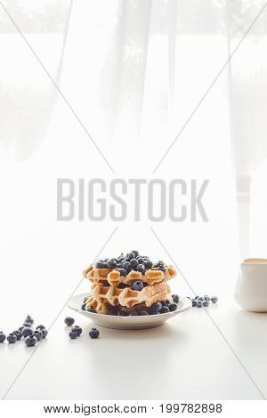 Plate Of Freshly Baked Waffles With Blueberries