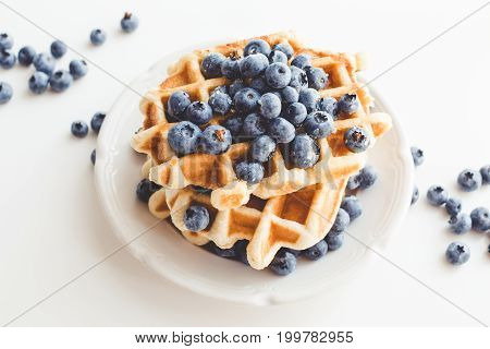 Plate Of Tasty Belgian Waffles With Blueberries