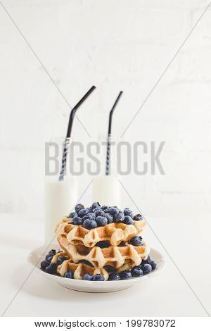 Delicious Breakfast Of Waffles With Blueberries And Milk Bottles