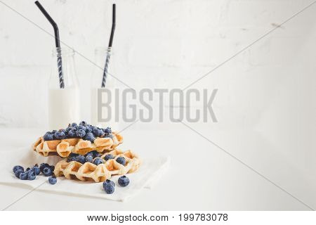 Delicious Breakfast Of Waffles With Blueberries And Milk With Copy Space