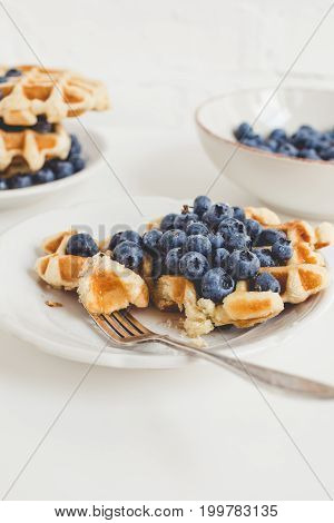 Composition Of Freshly Baked Waffles And Blueberries For Breakfast