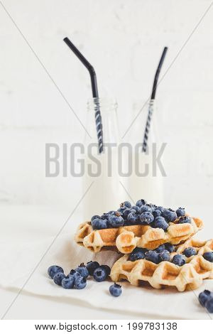 Delicious Breakfast Of Fresh Waffles With Blueberries And Milk