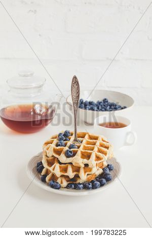 Tasty Breakfast Of Waffles With Blueberries And Tea