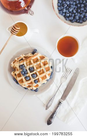 Delicious Breakfast Of Fresh Waffles With Blueberries And Tea
