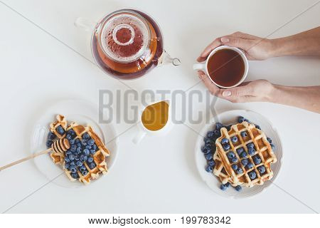 Top View Of Delicious Breakfast Of Tasty Waffles And Tea