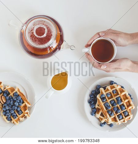 Top View Of Tasty Breakfast Of Waffles And Tea
