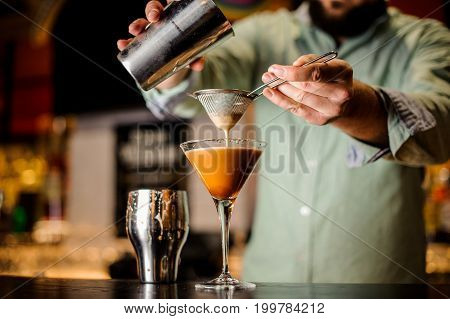 close up barmans hands with coffee cocktail no face