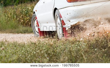 White Rally Car in dirt  track .