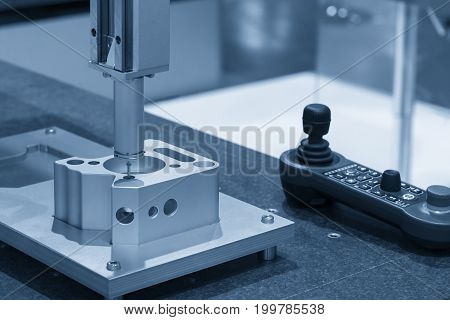 The CMM machine measure the aluminium sample part.The quality control concept.