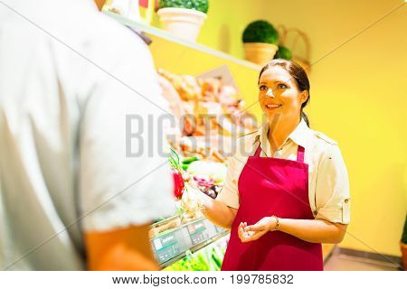 customer talking to sales clerk at the supermarket