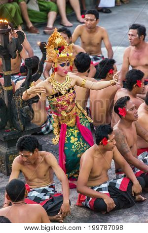 Bali, Indonesia - September 19, 2016: Traditional Balinese Kecak Dance at Uluwatu Temple in Bali, Indonesia. Kecak (also known as Ramayana Monkey Chant) is very popular cultural show on Bali.