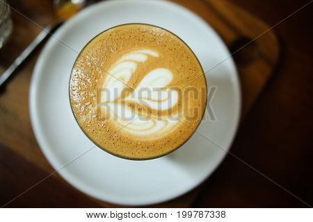 Coffee with hot rich latte art in the foam on top