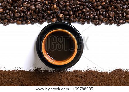White background with cup of coffee, coffee beans and ground coffee on below and above. View from above with space for text. Still life. Mock-up. Flat lay