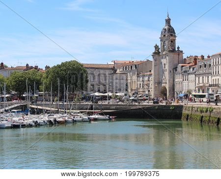 LA ROCHELLE, FRANCE, JULY 17 2017: View of the Old Port and gateway of the Big Clock in La Rochelle. One of the most historically rich cities on the Atlantic coast with a strong tourism industry.