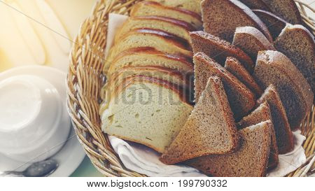 Homemade sliced white bread and whole grain bread in the basket served on the table in the restaurant