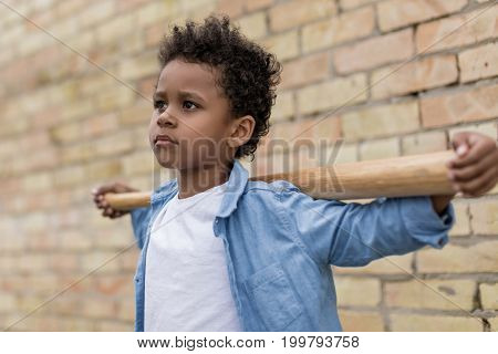 Beautiful Pensive Afro Boy With Baseball Bat On Shoulders