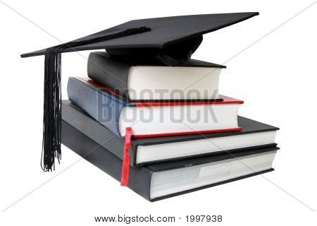 A Graduation Mortar On Top Of Books