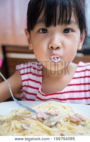 Asian Chinese Little Girl Eating Spaghetti