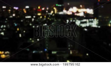 Blurred image of DSLR Camera on tripod taking photo of night urban cityscape