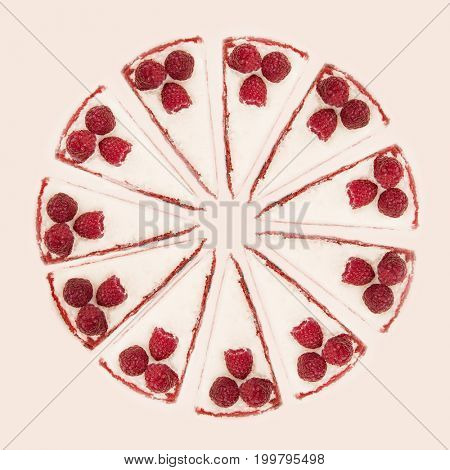 Circle of pies with raspberries and white cream isolated over white background